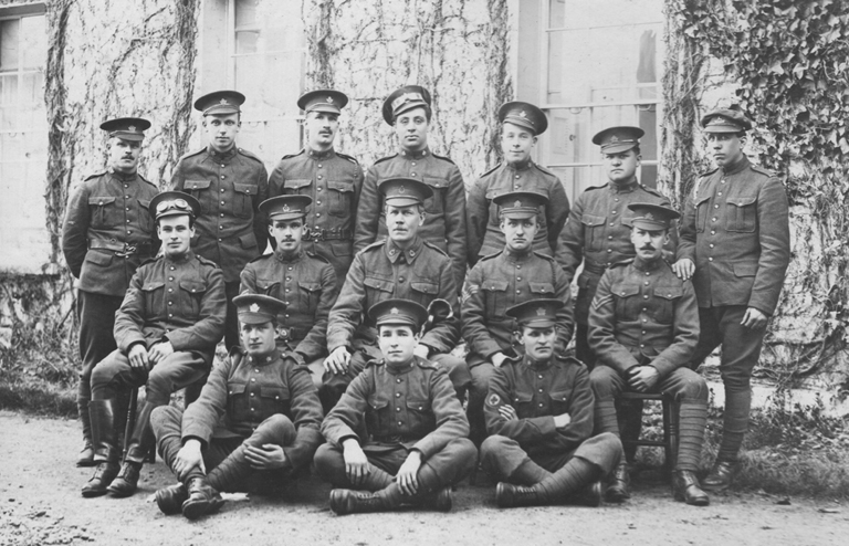 Soldiers in uniform pose for a group portrait