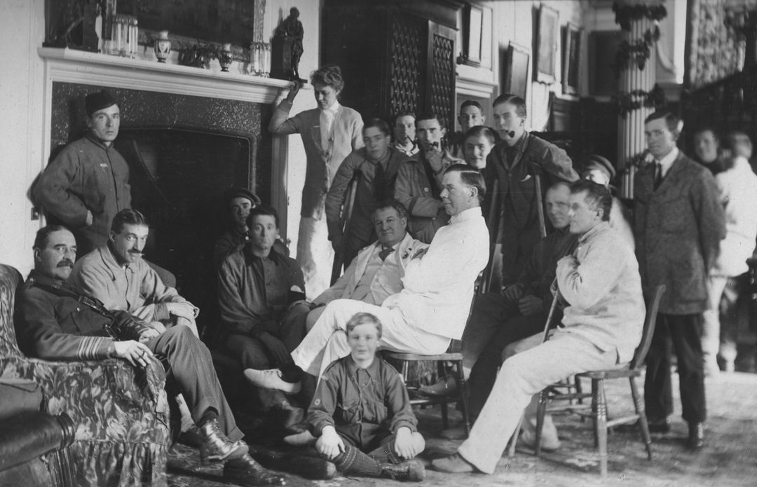 Doctors and soldiers relax near a fireplace
